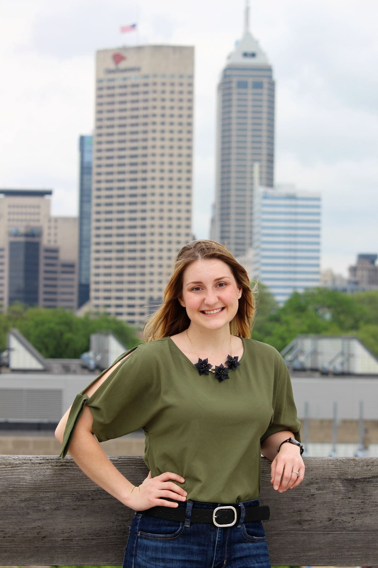Cassie Popplewell stands with Indy skyline behind