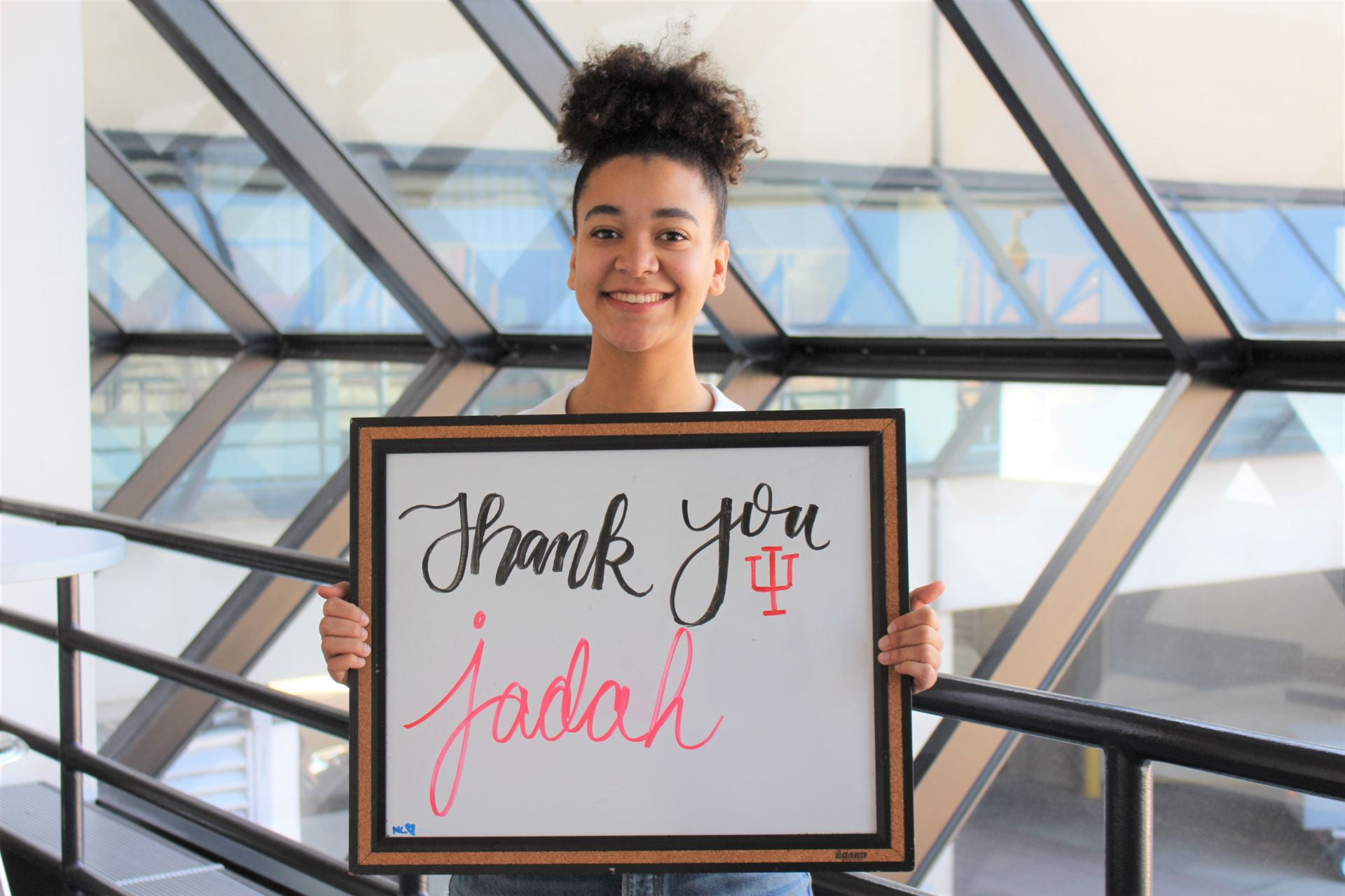 Jadah holding a thank you sign