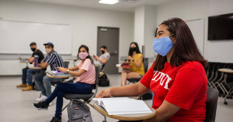 IUPUI students sitting in classroom at desks wearing masks