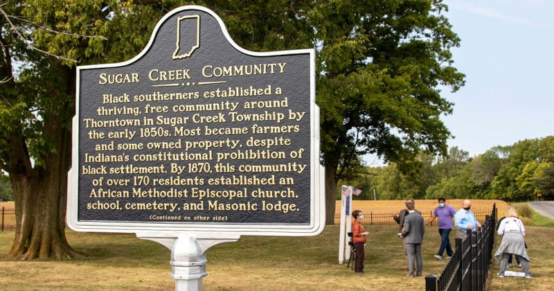 Historical sign that gives history of Sugar Creek Community