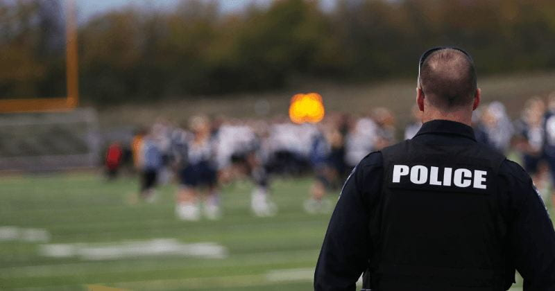 image of police officer at high school football game