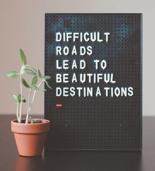 "Sign reading ""Difficult roads lead to beautiful destinations"""