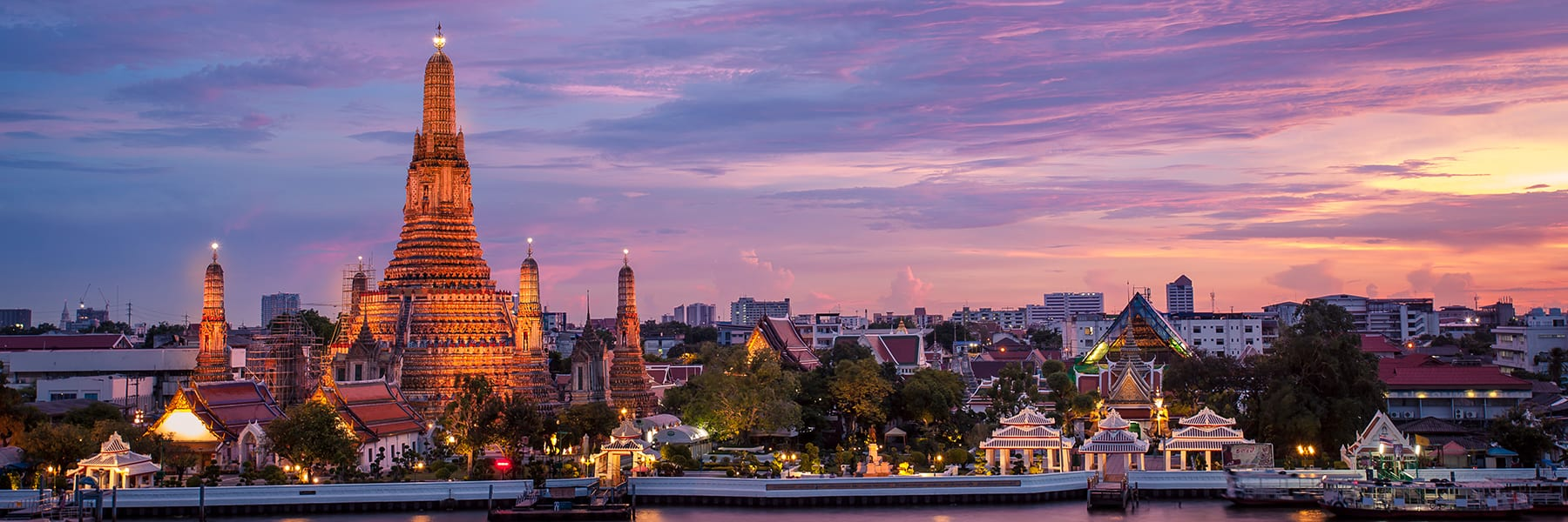 Sunset view of Wat Arun, a Buddhist Temple on the Chaophraya River Bangkok, Thailand