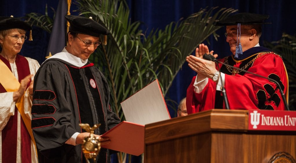 Indiana University President Michael McRobbie, right, confers upon Sombat Thamrongthanyawong an honorary degree during a ceremony in IUPUI's Hine Hall Auditorium Thursday, April 4, 2013. Sombat is President of Thailand's National Institute of Development Administration.