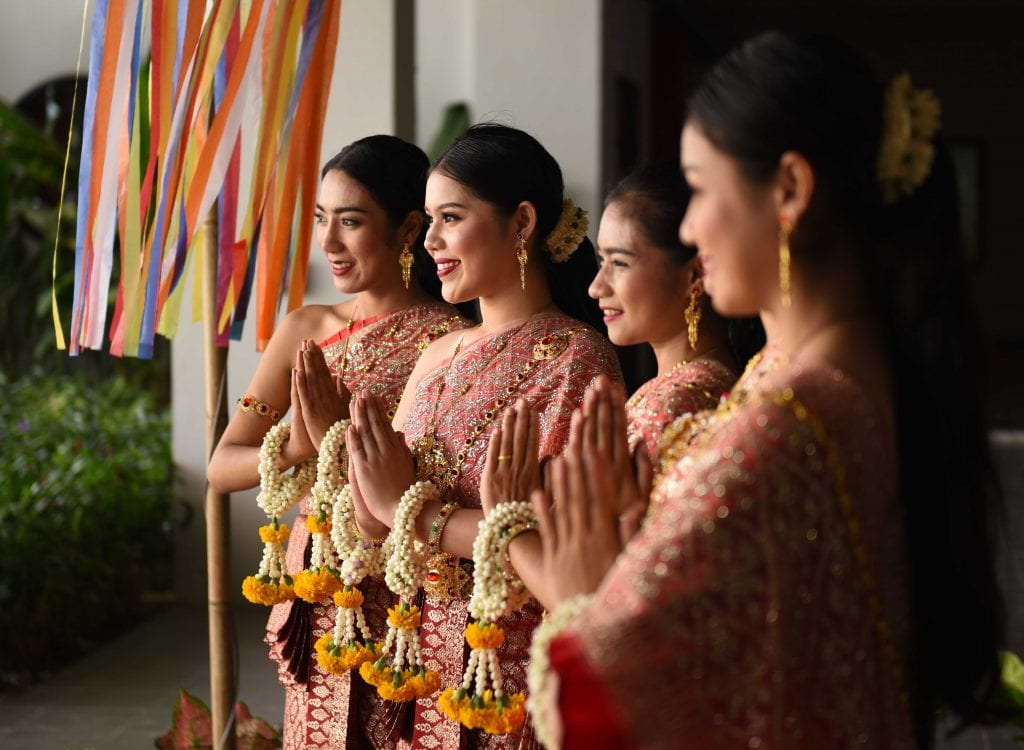 Walailak students dressed in traditional Thai attire and featuring jasmine and marigold garlands--also known as phuang malai--on their wrists, prepare to perform a welcome dance for the IUPUI delegation.