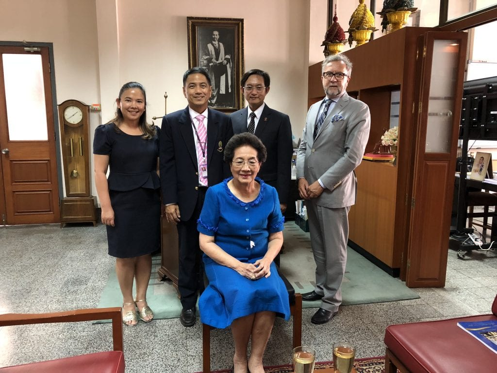 Dr. Thanpuying Petchara Techakampuch, 1959 graduate from the School of Dentistry with Michael Kowolik, Gabe Chu (both of IUSD), and two additional colleagues