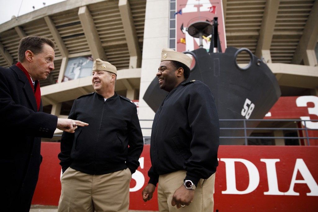USS Indiana (SSN-789) Commander Jesse J. Zimbauer, center, and Master Chief Lafrederick Herring speak with Indiana University Assistant Vice President for Strategic Partnerships Kirk White, left, in front of the prow and mast of the USS Indiana (BB-58), a WWII-era battleship, at Memorial Stadium at Indiana University Bloomington on Tuesday, Jan. 10, 2017. The USS Indiana (SSN-789) is a Virginia-class submarine expected to be christened in April and commissioned sometime in 2018.