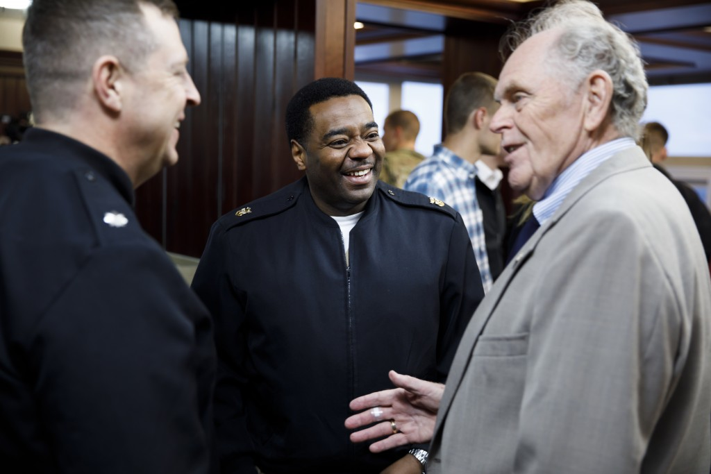 USS Indiana (SSN-789) Master Chief Lafrederick Herring, center, mingles during a reception for visitors representing the submarine at Memorial Stadium at Indiana University Bloomington on Tuesday, Jan. 10, 2017. The USS Indiana (SSN-789) is a Virginia-class submarine expected to be christened in April and commissioned sometime in 2018.