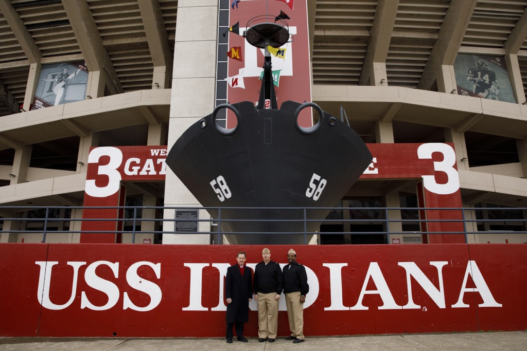 Indiana University Assistant Vice President for Strategic Partnerships Kirk White, left, USS Indiana (SSN-789) Commander Jesse J. Zimbauer and Master Chief Lafrederick Herring pose for a photo in front of the prow and mast of the USS Indiana (BB-58), a WWII-era battleship, at Memorial Stadium at Indiana University Bloomington on Tuesday, Jan. 10, 2017. The USS Indiana (SSN-789) is a Virginia-class submarine expected to be christened in April and commissioned sometime in 2018.