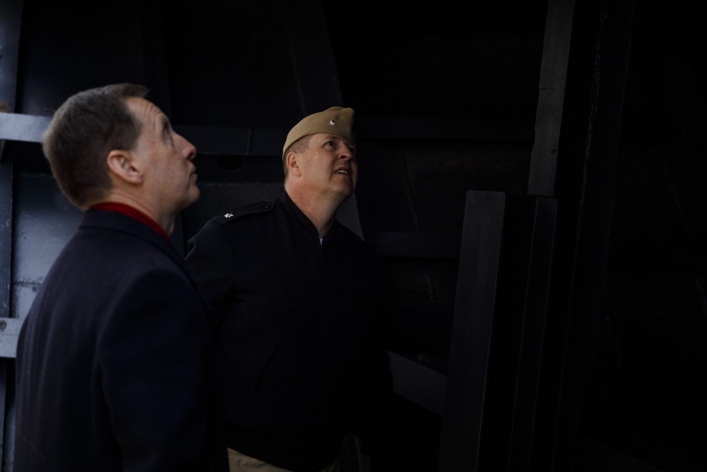 Indiana University Assistant Vice President for Strategic Partnerships Kirk White, left, gives USS Indiana (SSN-789) Commander Jesse J. Zimbauer a tour of the prow of the USS Indiana (BB-58), a WWII-era battleship, at Memorial Stadium at Indiana University Bloomington on Tuesday, Jan. 10, 2017. The USS Indiana (SSN-789) is a Virginia-class submarine expected to be christened in April and commissioned sometime in 2018.