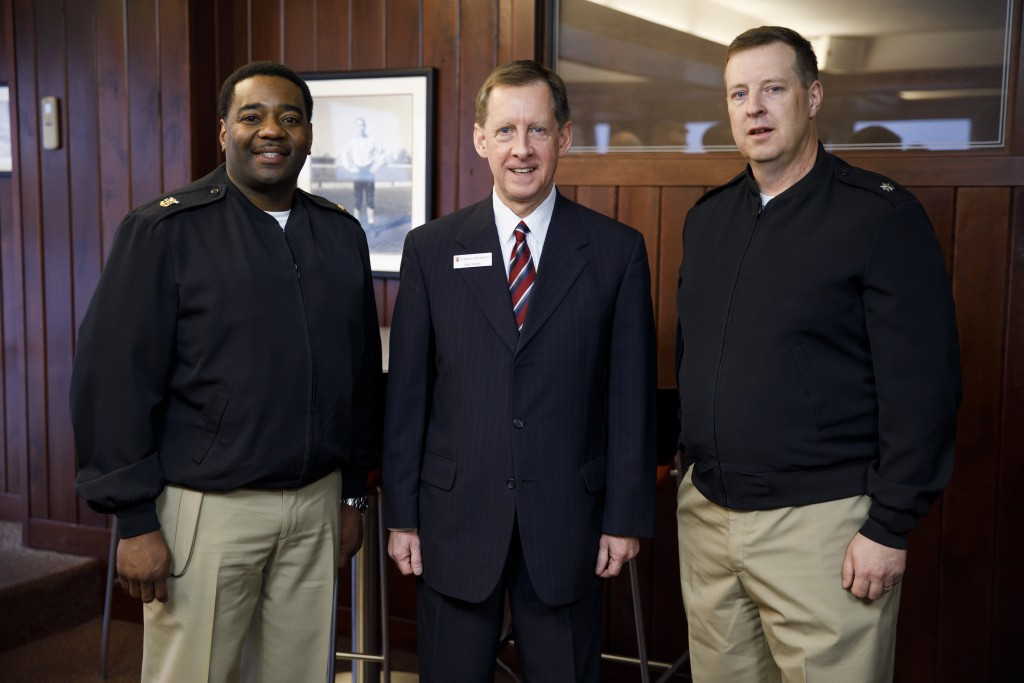 Indiana University Assistant Vice President for Strategic Partnerships Kirk White, center, poses for a photo with USS Indiana (SSN-789) Master Chief Lafrederick Herring, left, and Commander Jesse J. Zimbauer during a reception for visitors representing the submarine at Memorial Stadium at Indiana University Bloomington on Tuesday, Jan. 10, 2017. The USS Indiana (SSN-789) is a Virginia-class submarine expected to be christened in April and commissioned sometime in 2018.