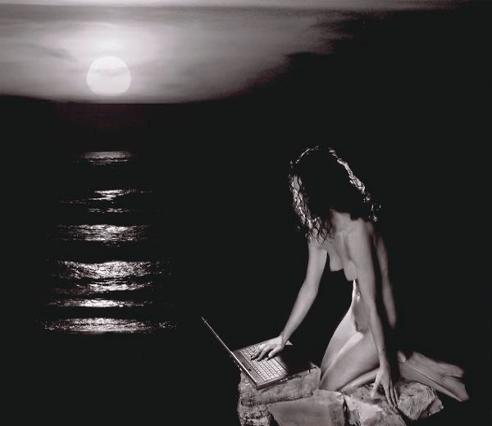 portrait of woman kneeling by moonlight water