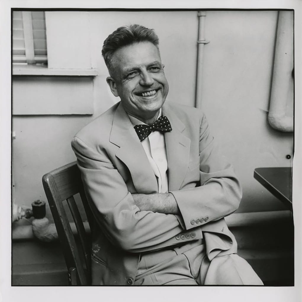 Dr. Alfred Kinsey seated, smiling.