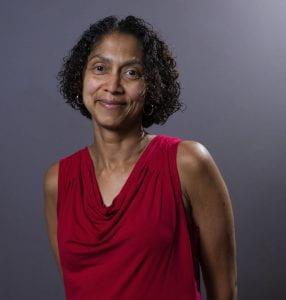 A portrait of Dr. Kosali Simon