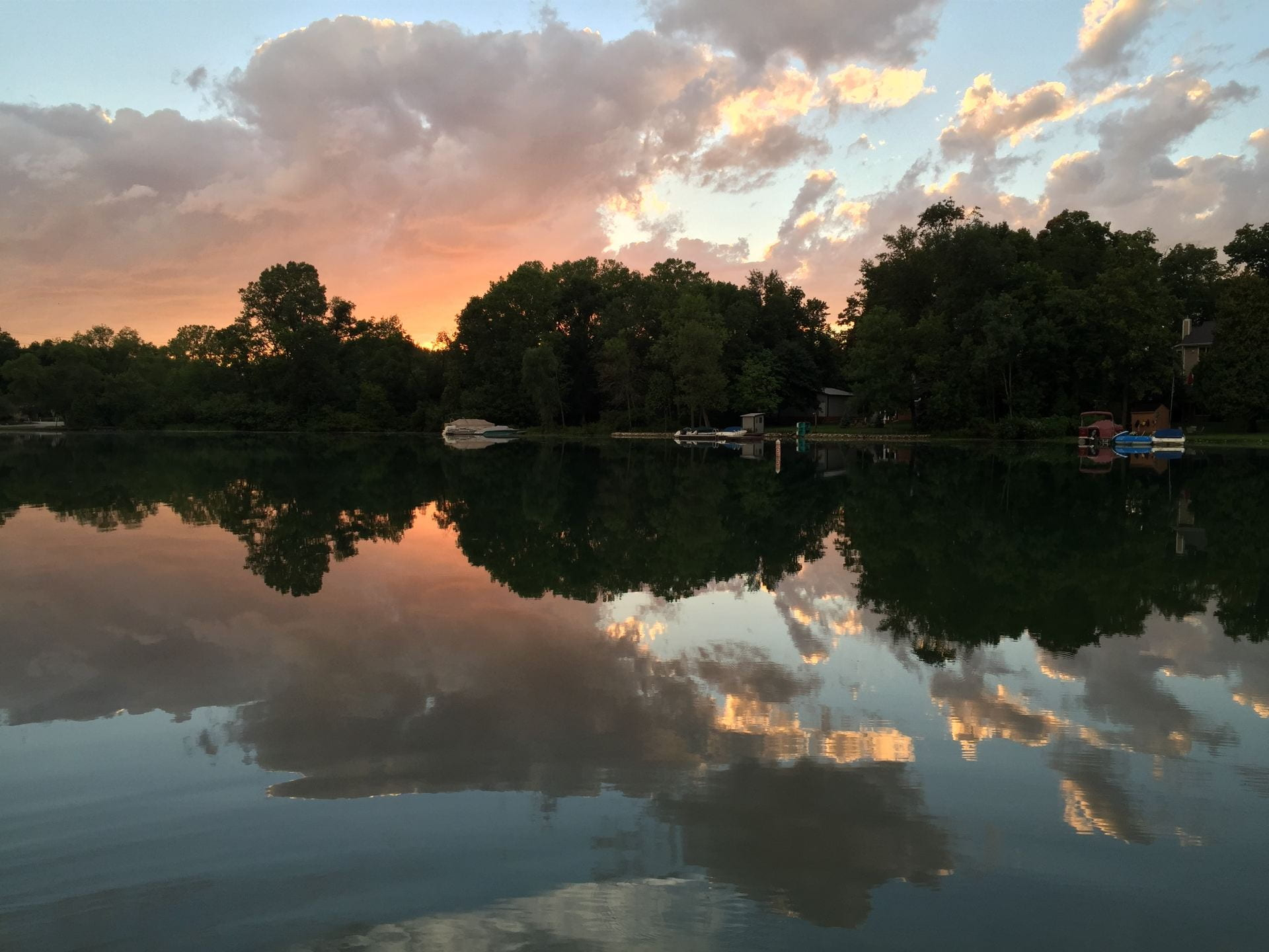 Sunset and clouds reflecting on Elkhart Lake