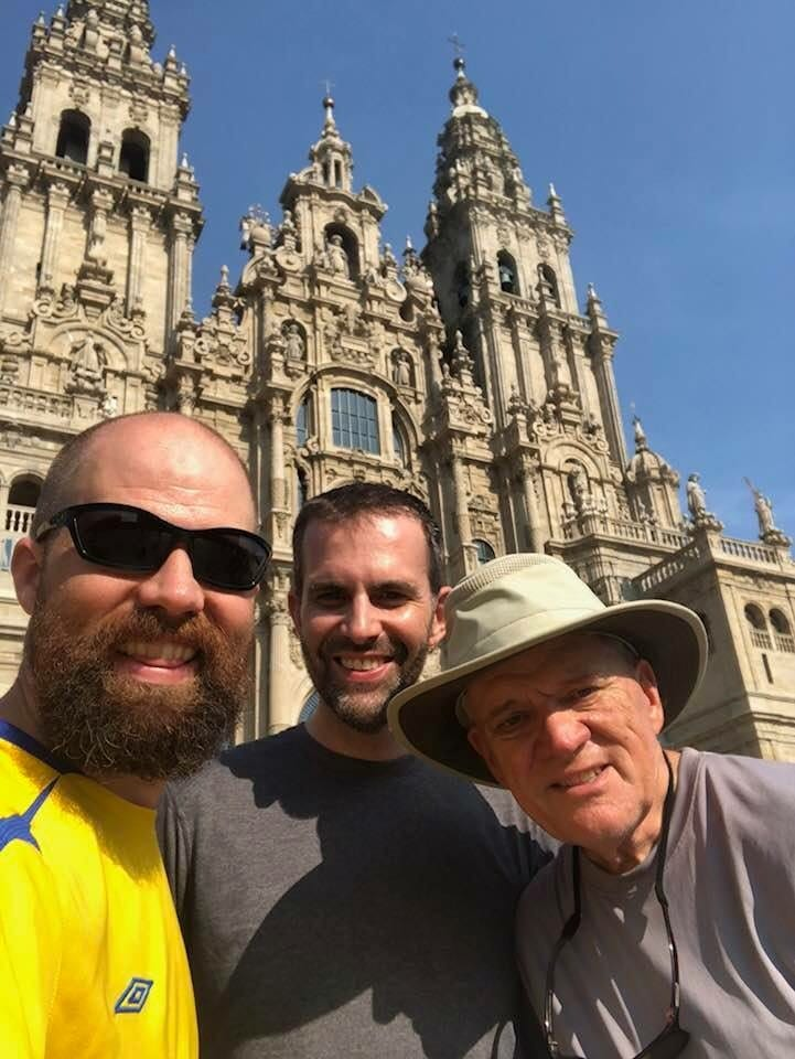 David King, Ph.D. (center), and friends at Santiago de Compostela Cathedral