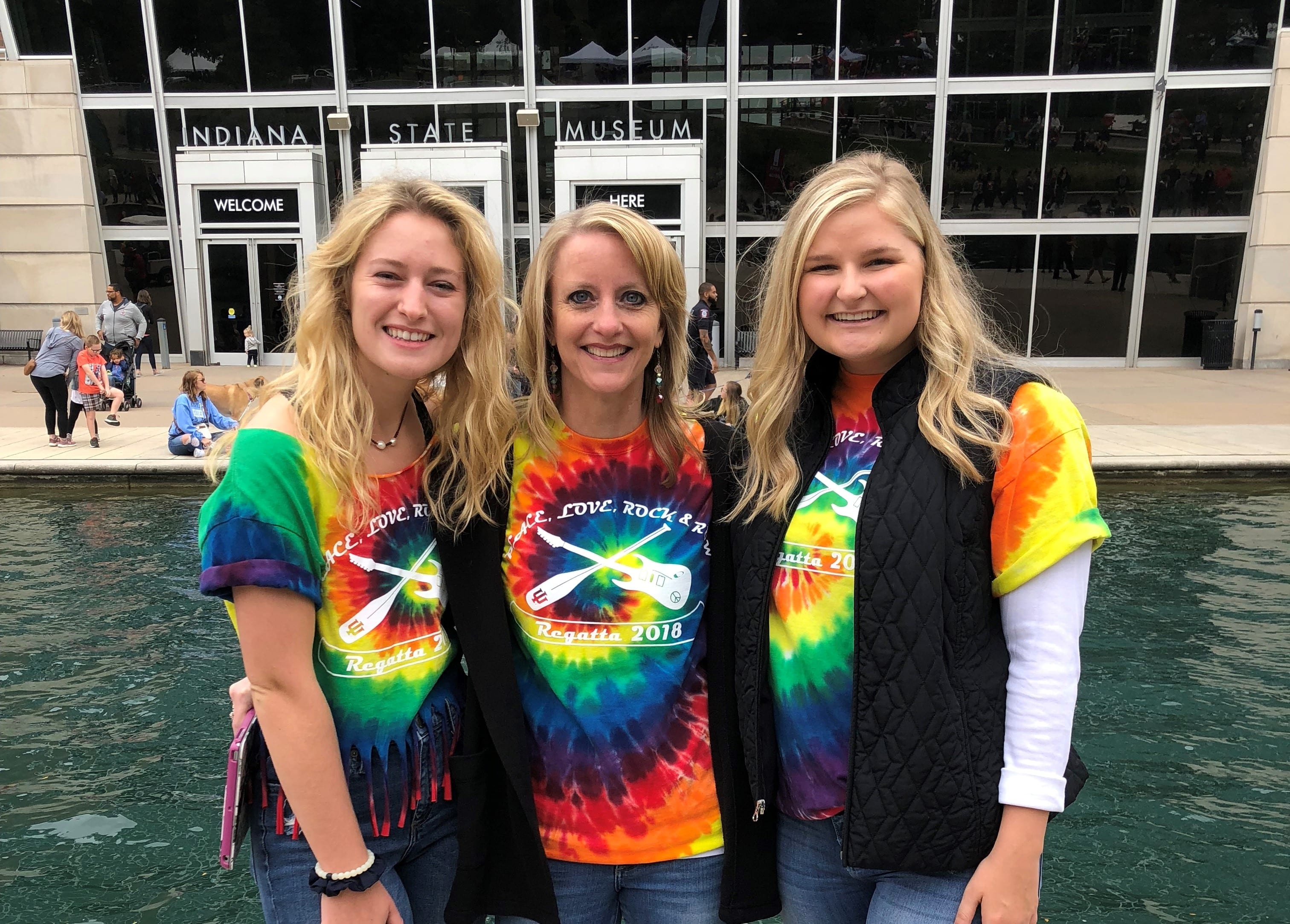 From l-r: Kellie Waring, Pamela Clark, and Justine Oppelt cheer on the Water Lillies team at the 10th Annual IUPUI Regatta
