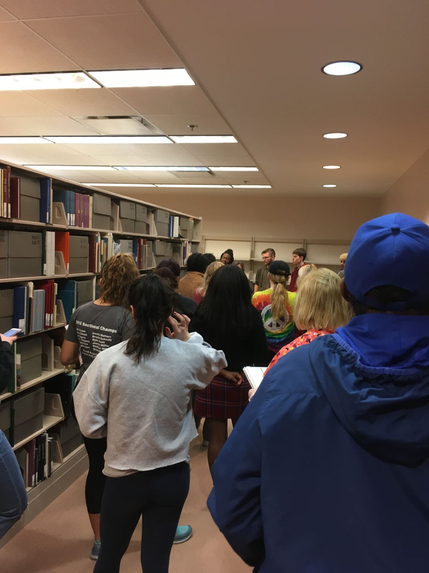 Students walk through the university's archives.