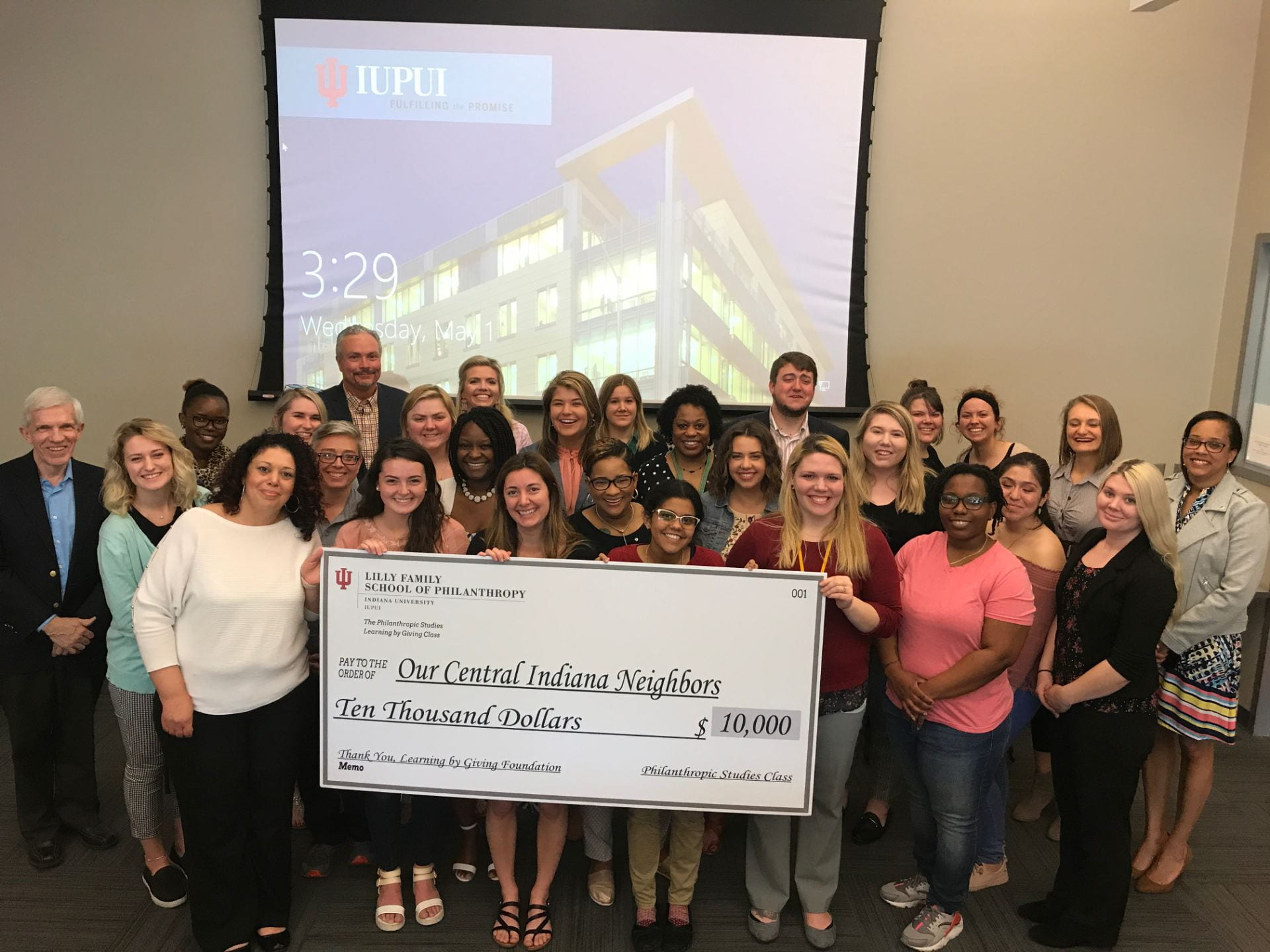 Students present the check to PACE.