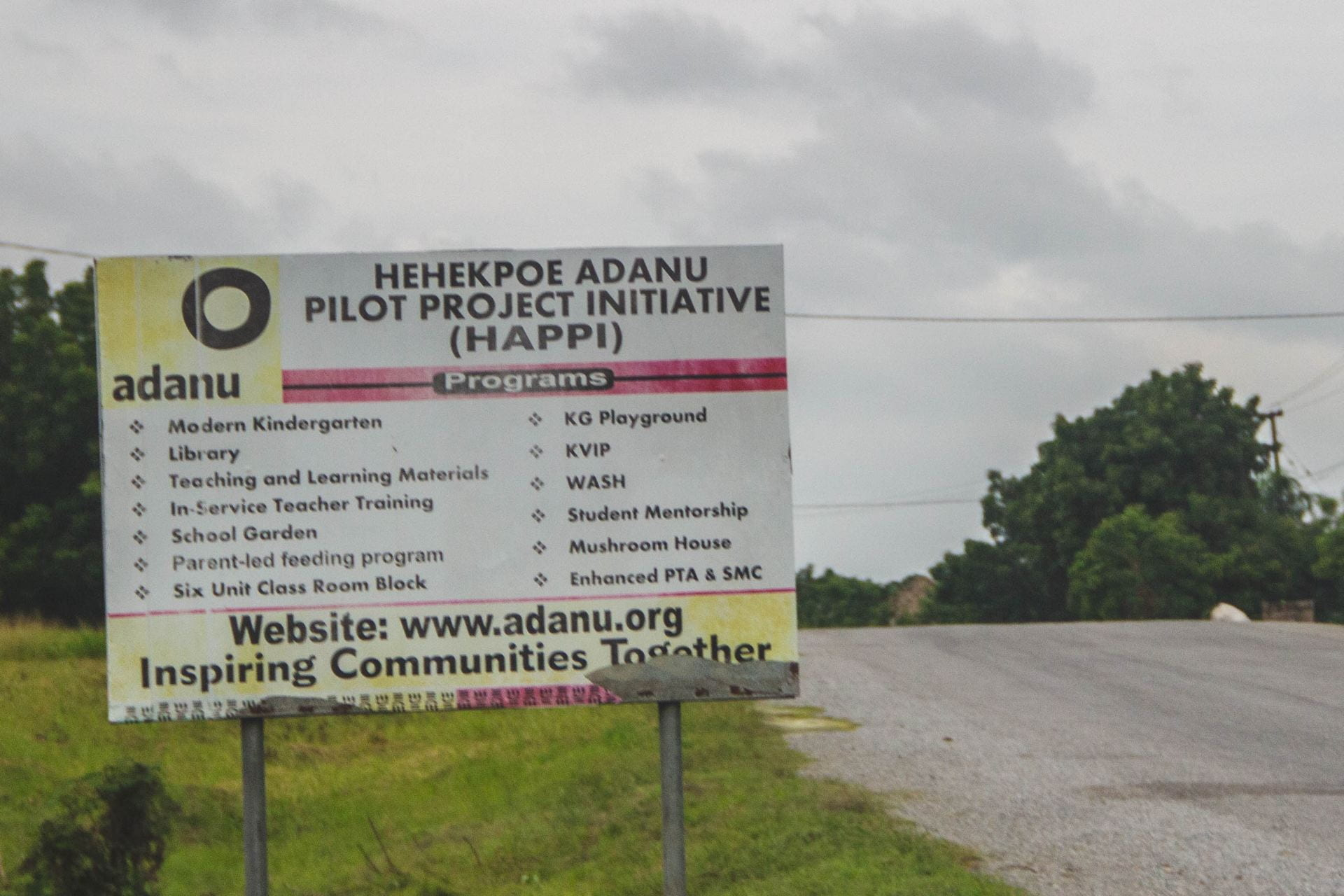 The sign outside of the village we visited. It lists the various projects the village is partnering with Adanu on.