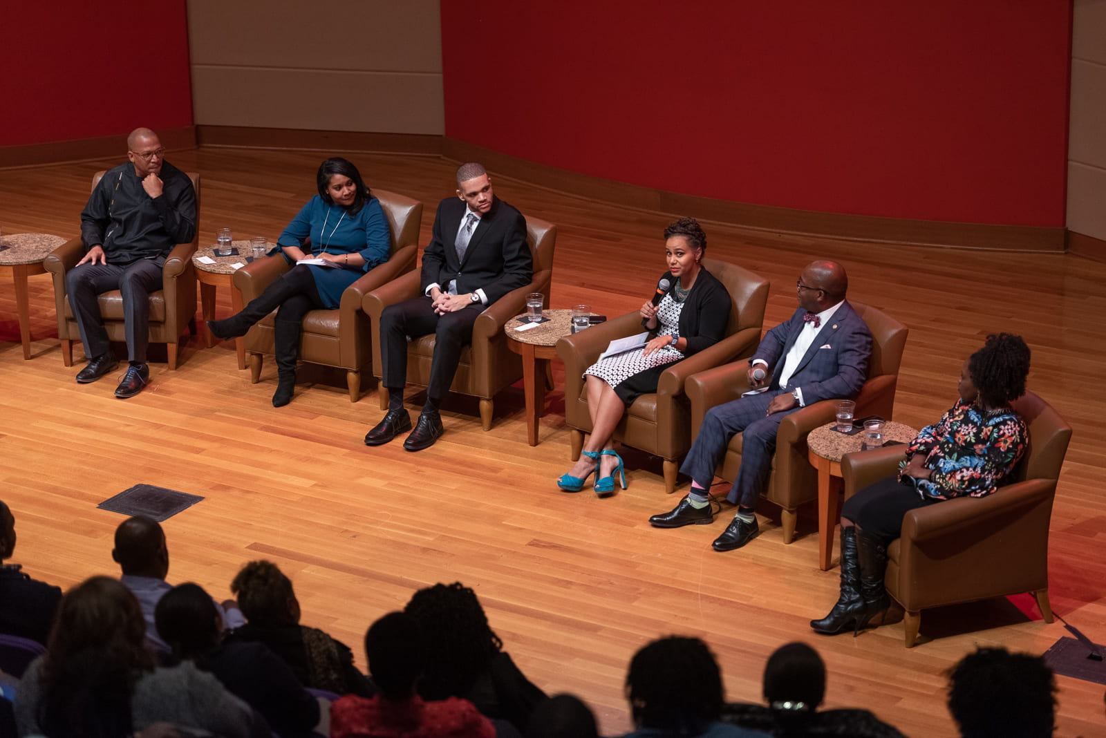 The featured panel members speak about their experiences. From left to right: Edward Jones, Charmaine Brown, Collin Mays, Tiara Dungy, Kim Nyoni, Akilah Wallace.