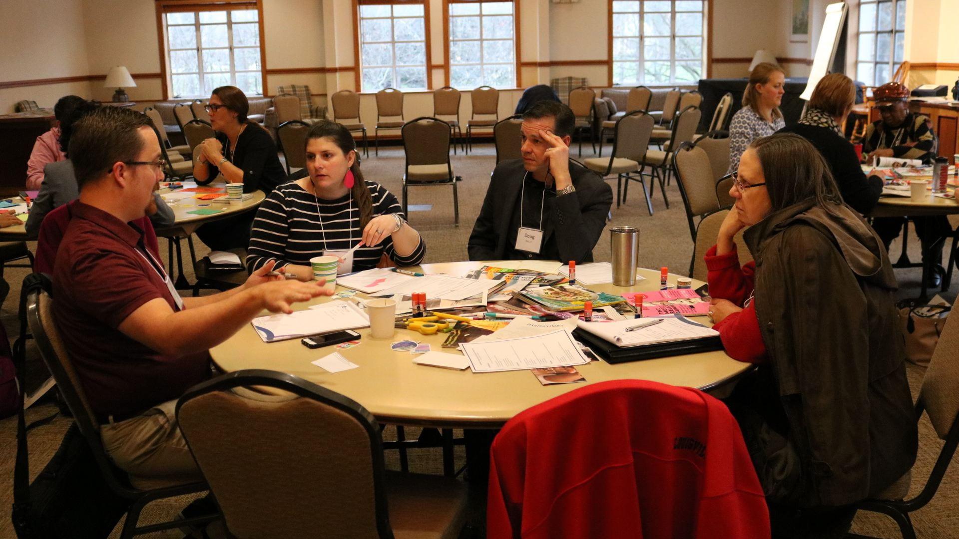 Participants discuss workshop materials.