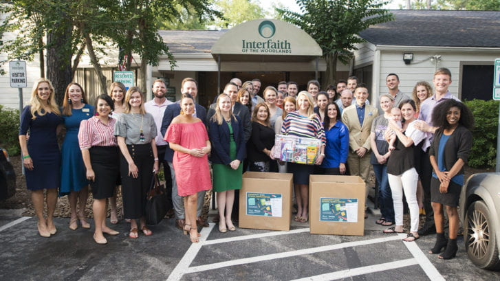 Individuals from Interfaith of The Woodlands gather to give back during the holiday season.