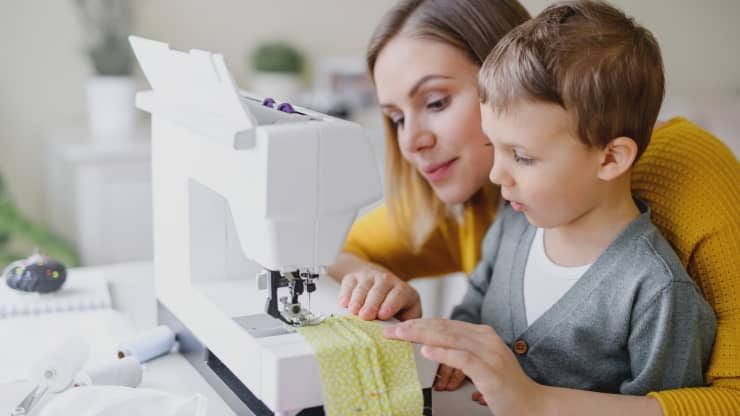 woman and child sewing together
