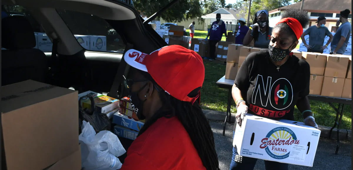 volunteers loading up supplies for donation