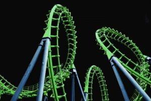 a green roller coaster set against a black background.