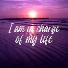 purple poster showing a bright rising sun with the phrase I am in charge of my life across the middle