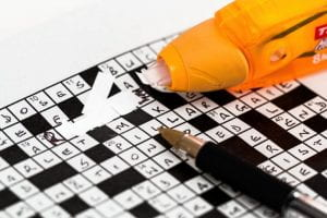 Crossword puzzle with white-out over an incorrect answer