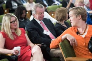 Marie Harf, left, speaks with Constanze Stelzenmuller, prior to a session