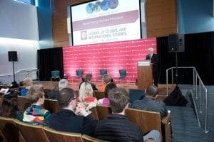 Richard Lugar, standing at a podium, addresses the audience