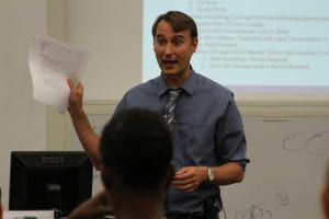 Professor Scott Shackelford lectures to a classroom