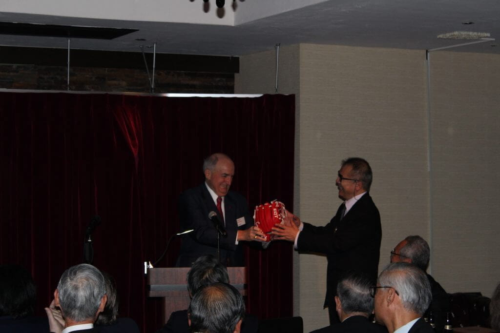 To commemorate the IU baseball team's 1922 trip to Japan, President McRobbie presents an authentic IU baseball glove to Shinoda Toru, dean of the Center for International Education at Waseda University.