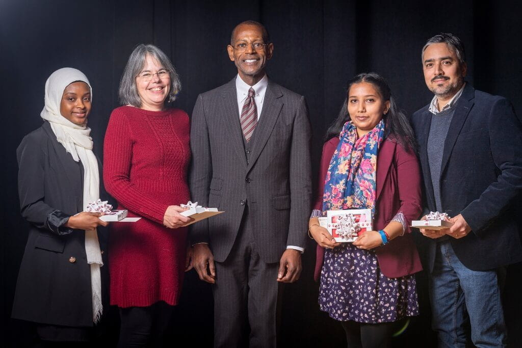 Winners of the 2019 Building Bridges Award pose with James C. Wimbush, vice president for diversity, equity and multicultural affairs. Pictured from left are Mariama Bah, Raquel Anderson, James Wimbush, Trishnee Bhurosy and Cristian Medina.