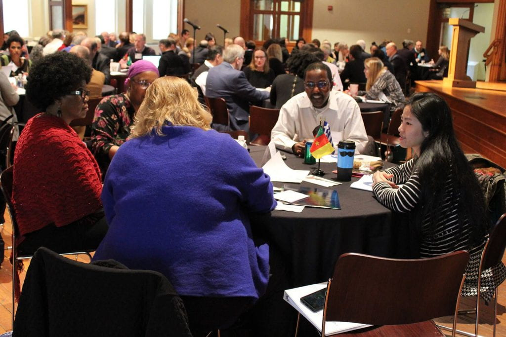 Summit participants work in small groups