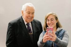 Senator Richard Lugar takes a selfie with a Hamilton Lugar School student during the fourth annual conference on America's Role in the World® at Indiana University