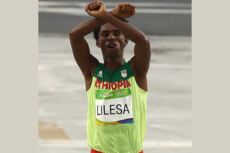 Feyisa Lilesa posing after race