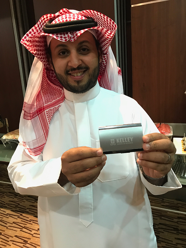 Faisal A. Alkadi, 2016 Kelley alum poses with his Kelley business card holder