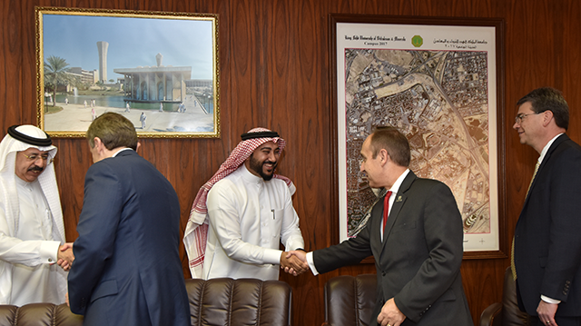 Chancellor Nasser H. Paydar shakes hands with Dr. Nasser Aqeeli, Dean of Scientific Research at King Fahd University of Petroleum and Minerals
