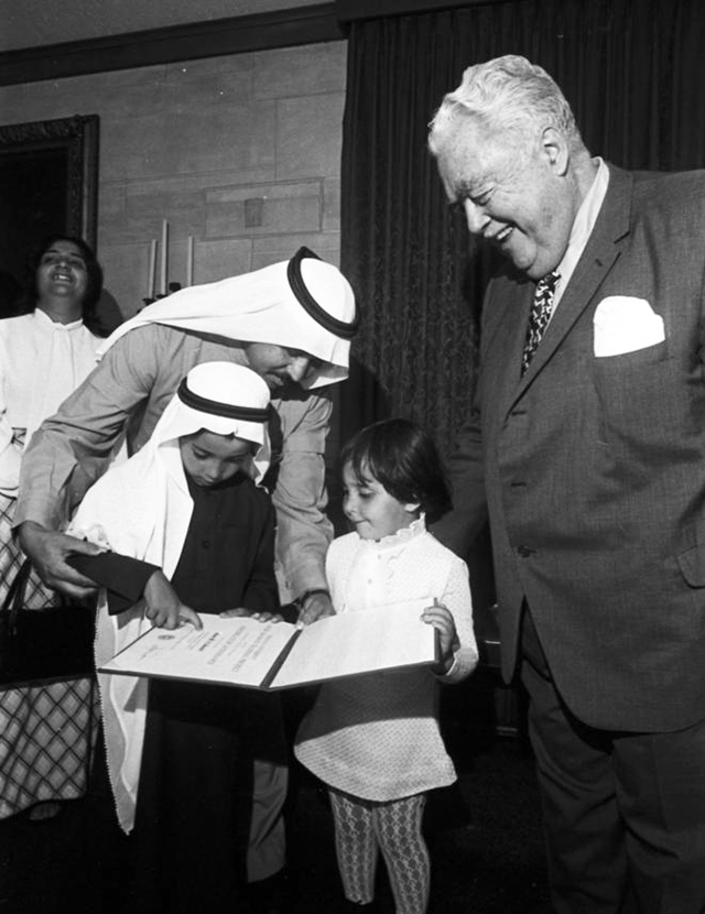 "This image appears on page 4 of the September 1974 edition of the Indiana Alumni Magazine. The caption reads, in part: ""Hasan M. AlJawadi, one of the first Saudi Arabian educators to enroll in a special program at IU Bloomington shows his Certificate of Attendance to his son Mustafa, 6, and daughter Hanadi, 4...Financed by the Saudi Arabian government, the program trains Saudi Arabian manpower to manage its own educational system."""