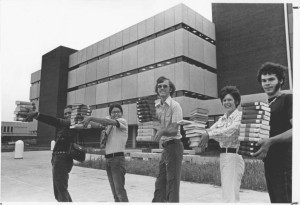"Students participate in a ""book walk"" and carry books to the new library in September 1972. Courtesy of Helmke Highlights, September 2012, Volume 5 Issue 3."