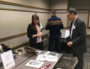 IU East student Cassidy Clouse shows her work to James Capshew.