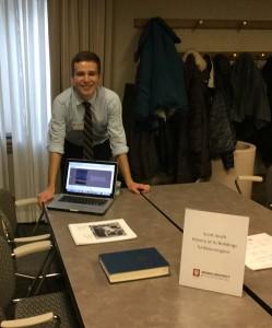 Senior Scott Jauch shows off his timeline research.
