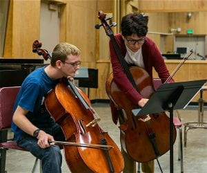 Cello teacher working with student in the studio.