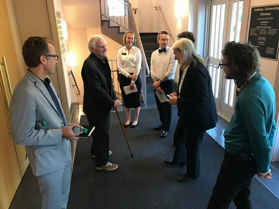 John Boorman visits with ushers, house manager Seth Mutchler and IU Cinema director Jon Vickers in IU Cinema lobby before Boorman's Jorgensen Lecture.