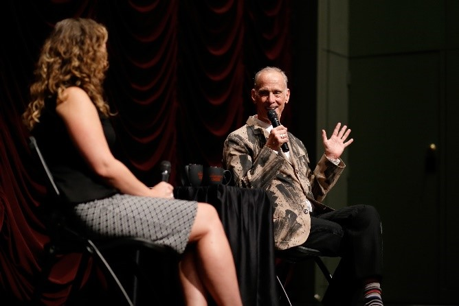 Brittany D. Friesner and John Waters