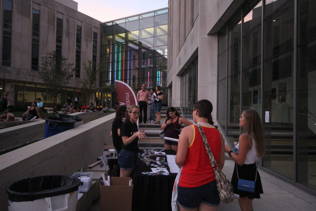 IU Cinema's Promotional Street Team engaging students at outdoor screening of Spirited Away during IU Cinema Under the Stars series last fall.